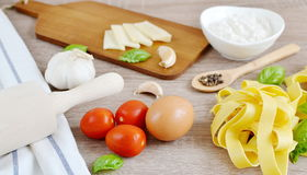Preparation Italian Raw Homemade Pasta Tagliatelle Cooking. Baking Kitchen Table Wooden Different Ingredients Eggs Olive Oil Tomato Flour Basil Pepper Garlic Stock Images