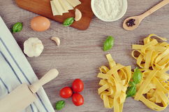 Preparation Italian Raw Homemade Pasta Tagliatelle Cooking. Baking Kitchen Table Wooden Different Ingredients Eggs Olive Oil Tomato Flour Basil Pepper Garlic Stock Image