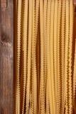 Preparation of Italian Ribbon-shaped Pasta: Reginette or Mafaldine.  Royalty Free Stock Photo