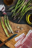 Preparation of italian simple dish, asparagus and pancetta Royalty Free Stock Photo
