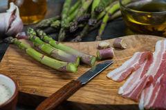 Preparation of italian simple dish, asparagus and pancetta Stock Photo