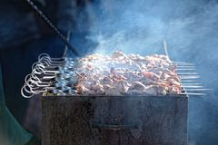 Preparation of kebab (shashlik) on brazier on street Royalty Free Stock Photos