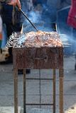 Preparation of kebab (shashlik) on brazier on street Stock Photo