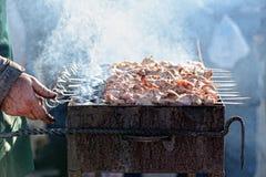Preparation of kebab (shashlik) on brazier on street Royalty Free Stock Photography