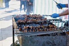 Preparation of kebab (shashlik) on brazier on street Royalty Free Stock Image