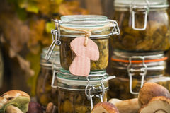Preparation kitchen mushrooms marinated jars wooden table Royalty Free Stock Photos