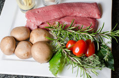 Preparation for  lamb filets with mushrooms Royalty Free Stock Photos