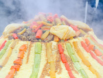 Preparation of a large couscous outdoors. Moroccan festival Stock Image