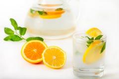 Preparation of the lemon and orange juice Stock Images
