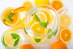 Preparation of the lemon and orange juice Stock Photography