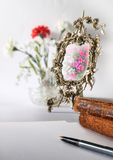 Preparation for the letter. Still life with a female bronze mirror, books and a fountain pen Royalty Free Stock Photo