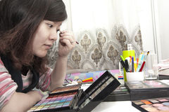 Make-up woman girl. Preparation of make-up Asia woman.Are painting eye shadow Royalty Free Stock Photo