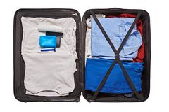 Preparation for man travel. Top view of male clothes and accessories for travel in valise Stock Photography