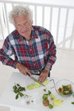 PREPARATION MEAL SENIOR stock photography