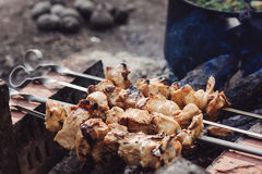 Preparation of meat slices in sauce on fire Royalty Free Stock Photos