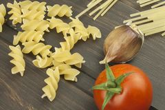 Preparation menu. Pasta and vegetables on a wooden table. Dietary food. Royalty Free Stock Photography