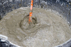 Preparation of a mixture of a tile adhesive with mixer Royalty Free Stock Photography