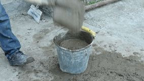 Preparation of mortar with a shovel stock video footage