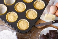 Preparation of muffins close-up horizontal top view Stock Image