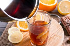 Preparation of mulled wine with orange and spices Stock Photos