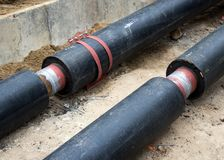 Preparation of new heating pipes for trenching.  Stock Photos