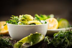 Preparation Of Avocados In Green Salad Royalty Free Stock Photography