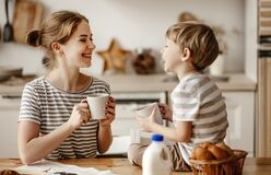 Free Preparation Of Family Breakfast. Mother And Child Son Cut Bread  And Eat Cookies With Milk In Morning Royalty Free Stock Images - 173713099