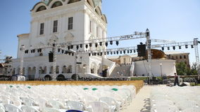 Preparation for an open-air concert near a church in Russia, installing of lights, decorations stock video footage