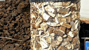 Preparation and packaging of firewood for transport. Machines for preparing and packing firewood for transport with forklift,video clip stock footage