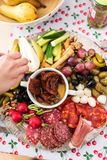 Preparation of a party platter with meats and cheese Stock Photos