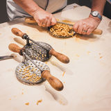 Preparation of passatelli fresh pasta using traditional tool Royalty Free Stock Photography