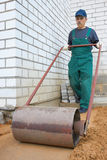 Preparation for a paving. The worker prepares a place for a paving Royalty Free Stock Photos