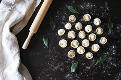 Preparation of pelmeni. Top view. Ingredients on black table. Traditional Russian cuisine. Preparation of pelmeni. Top view. The Ingredients on a black table royalty free stock photos