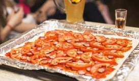 Cooking pizza at home on a baking sheet royalty free stock photography