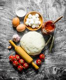 Preparation pizza. Various ingredients for cooking pizza. On rustic background stock photo