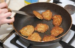 Preparation of potato fritters. On a frying pan Royalty Free Stock Photos