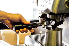 Preparation process of hot coffee. Royalty Free Stock Image
