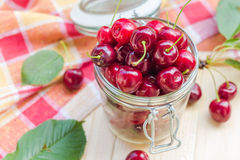 Preparation products processed fresh colorful summer fruits jars Royalty Free Stock Image
