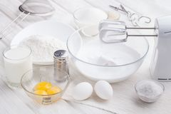 Preparation of a protein cream on a white wooden table. Stock Photos