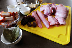 Preparation of the rabbit for roasting in the oven. Pieces of the rabbit for roasting in the oven. Spices, mustard, bacon and white wine for seasoning royalty free stock photos