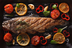 Preparation of rainbow trout on the grill closeup. Horizontal to Stock Images