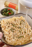 The preparation of rapid noodles by the boiling wa Royalty Free Stock Photos