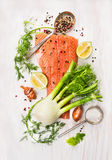 Preparation with raw salmon fillet,fennel, dill, lemon. And onion on white wooden background, top view Stock Photography