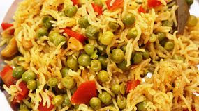 Preparation of Rice and Peas Pulao Royalty Free Stock Photo