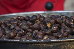 Preparation of roasted chestnuts Stock Photo