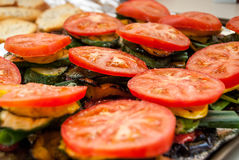 Preparation of Roasted Vegetable Sandwiches. Tomatoes, zucchini, and other vegetables are stacked in sandwiches waiting to be roasted royalty free stock photos