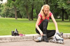 Preparation for rollerskating Royalty Free Stock Image