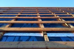 Preparation of roof roof before installation of sheets of metal tiles with insulation, waterproofing with the help of film, boards royalty free stock photo