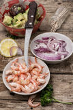 Preparation of salad with prawns Stock Photos