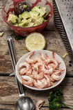 Preparation of salad with prawns Stock Image